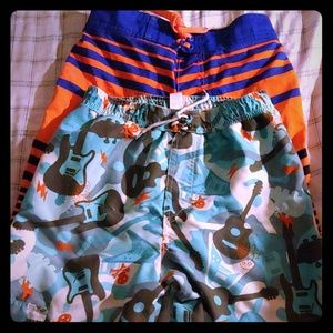 Two pairs of boys swim trunk board shorts